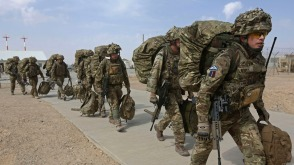British troops prepare to depart upon the end of operations for U.S. Marines and British combat troops in Helmand