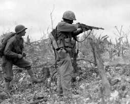 Men of the 1st Marine Division on Wana Ridge with Browning Automatic Rifle.